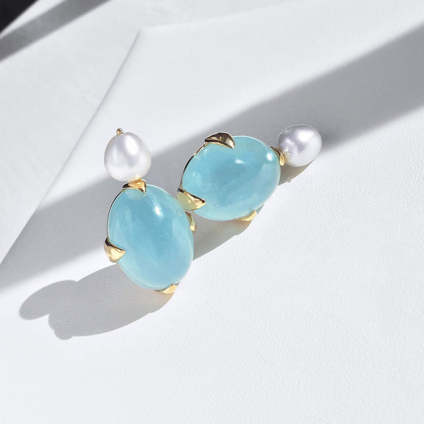 Aquamarine cabochon & pearl earrings. yellow gold