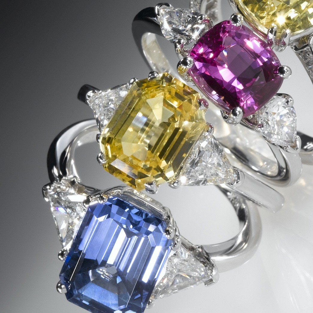 FROM LEFT: SAPPHIRE & DIAMOND RINGS: EMERALD CUT BLUE SAPPHIRE. EMERALD CUT YELLOW SAPPHIRE. OVAL PINK SAPPHIRE. CUSHION CUT YELLOW SAPPHIRE