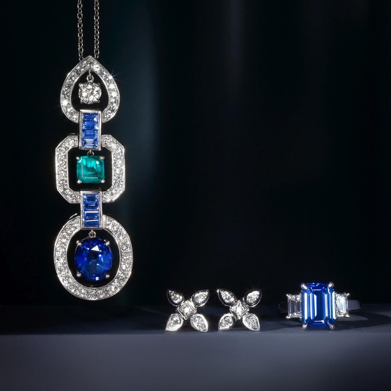 EMERALD, SAPPHIRE, & DIAMOND PENDANT. SEVILLA EARRINGS. EMERALD CUT BLUE SAPPHIRE & DIAMOND RING. SAPPHIRE 4.67 CTS