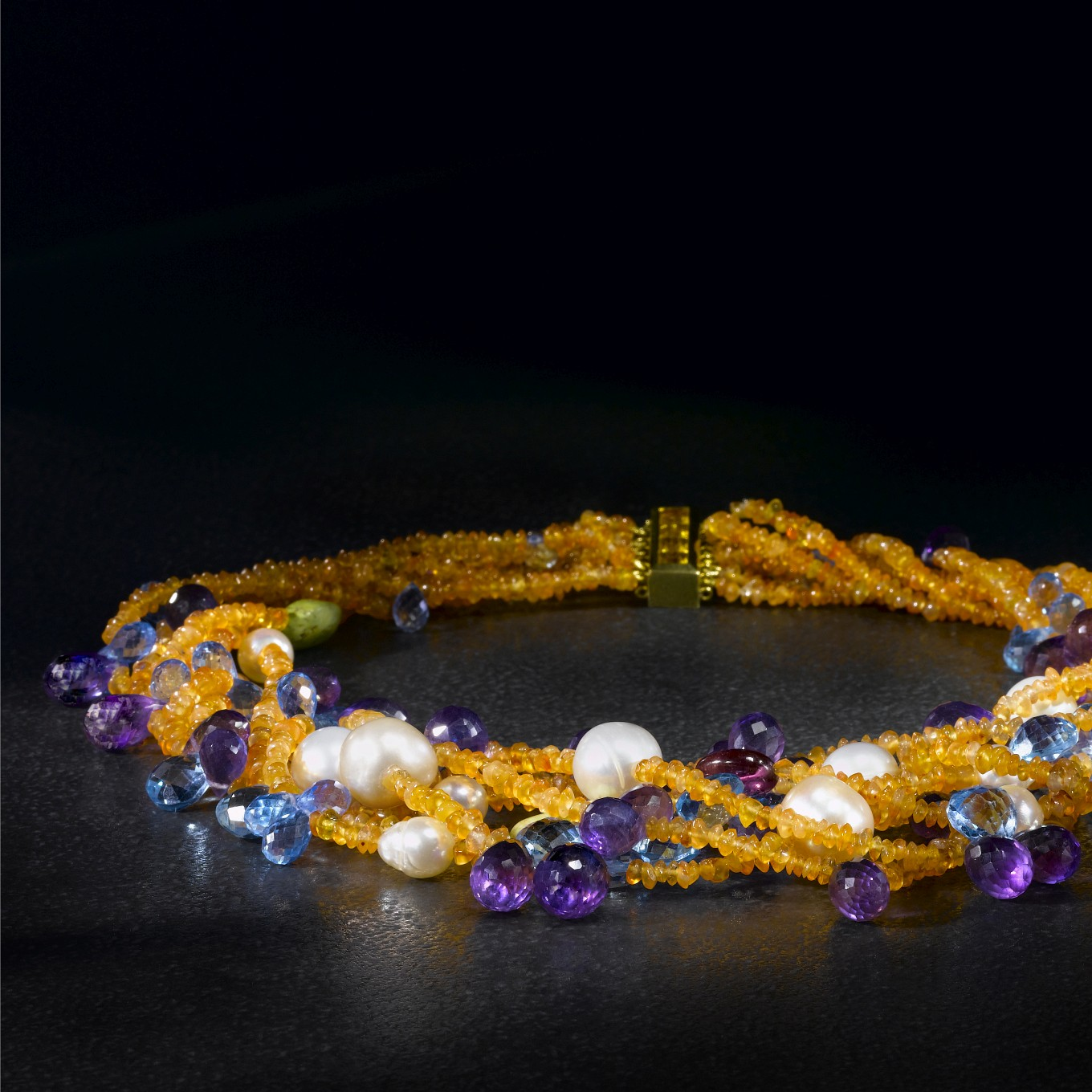 FROM A COLLECTION OF MULTISTONE CHOKERS: CARNELIAN, AMETHYST, BLUE TOPAZ, RUBELLITE, PEARL & GREEN TOURQUOISE NECKLACE WITH CITRINE BAR CLASP