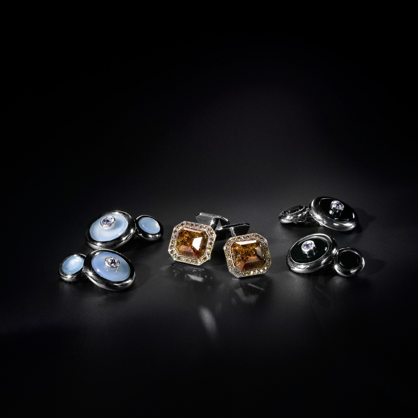'MEN'S DRESS CUFFLINKS IN WHITE GOLD FROM LEFT: CHALCEDONY & ROSE CUT DIAMONDS, CHOCOLATE DIAMOND & BROWN DIAMONDS, ONYX & ROSE CUT DIAMONDS