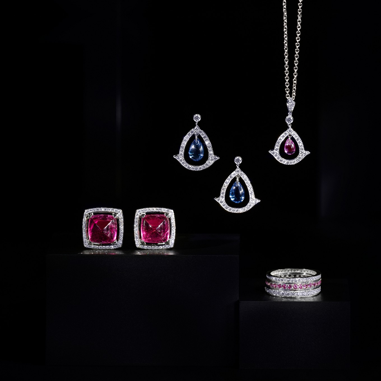PINK TOURMALINE SUGARLOAF CABOCHON AND DIAMOND FRA...