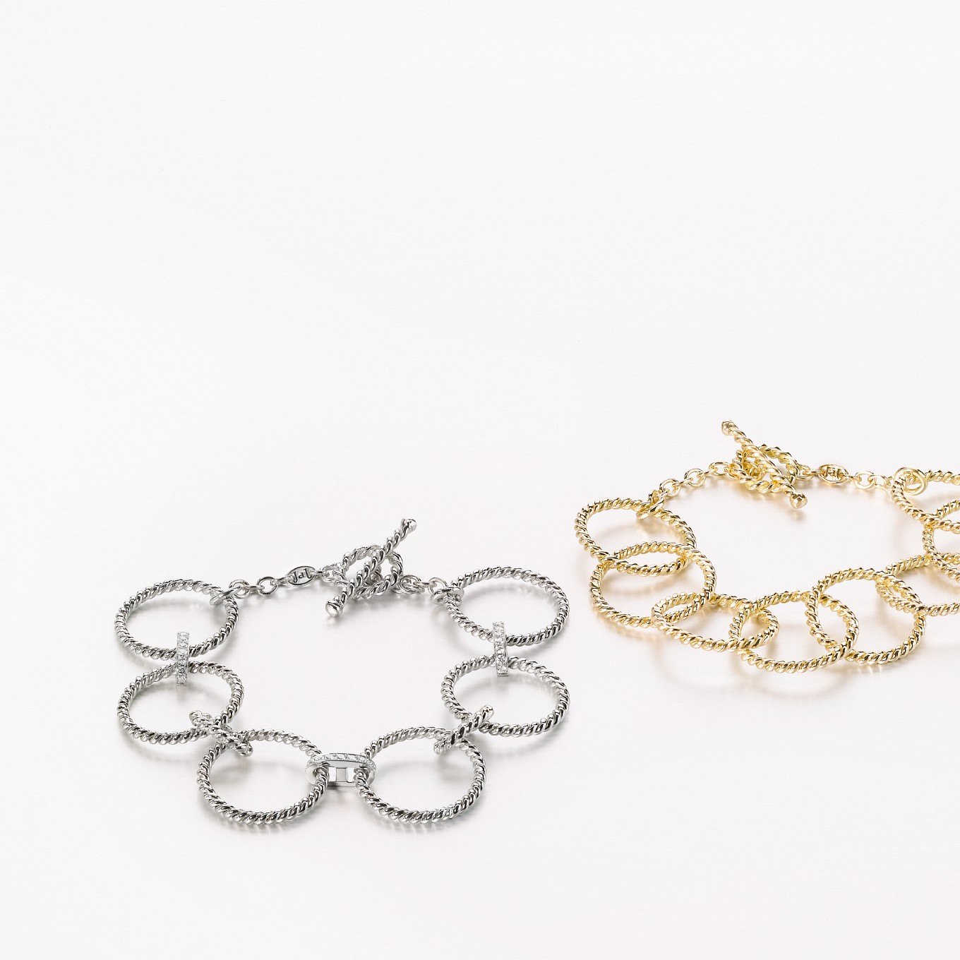 'EQUUS'  BRAID BRACELET IN WHITE GOLD WITH DIAMOND LINKS. 'EQUUS'  BRAID BRACELET IN YELLOW GOLD