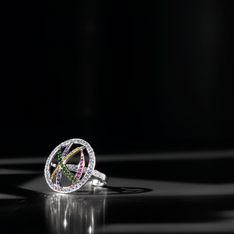 FLARE RING WITH YELLOW, BLUE, & PINK SAPPHIRES, TSAVORITE GARNET & DIAMONDS
