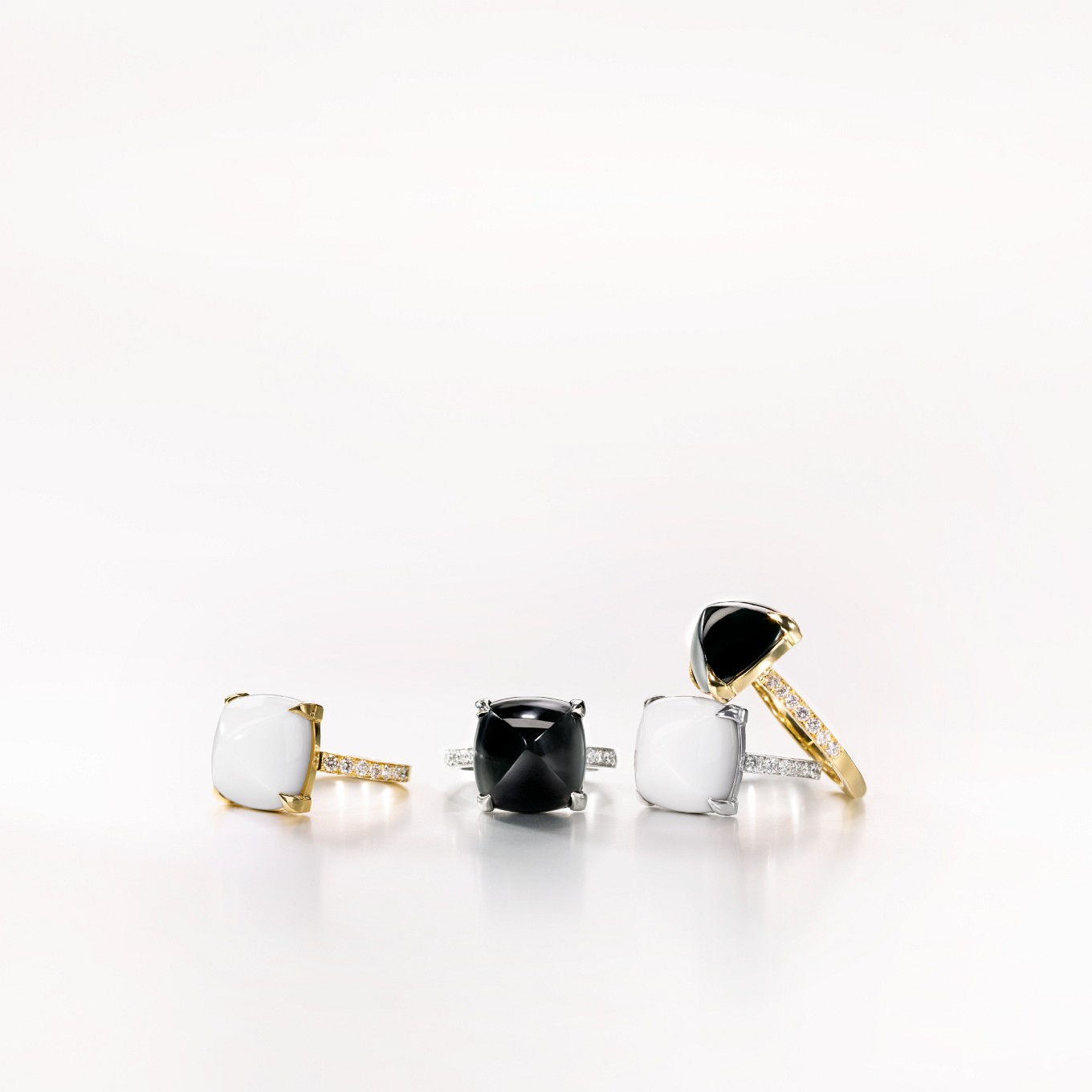 TUSCAN RINGS IN BLACK JADE & COCHOLONG & DIAMONDS IN EITHER WHITE OR YELLOW GOLD