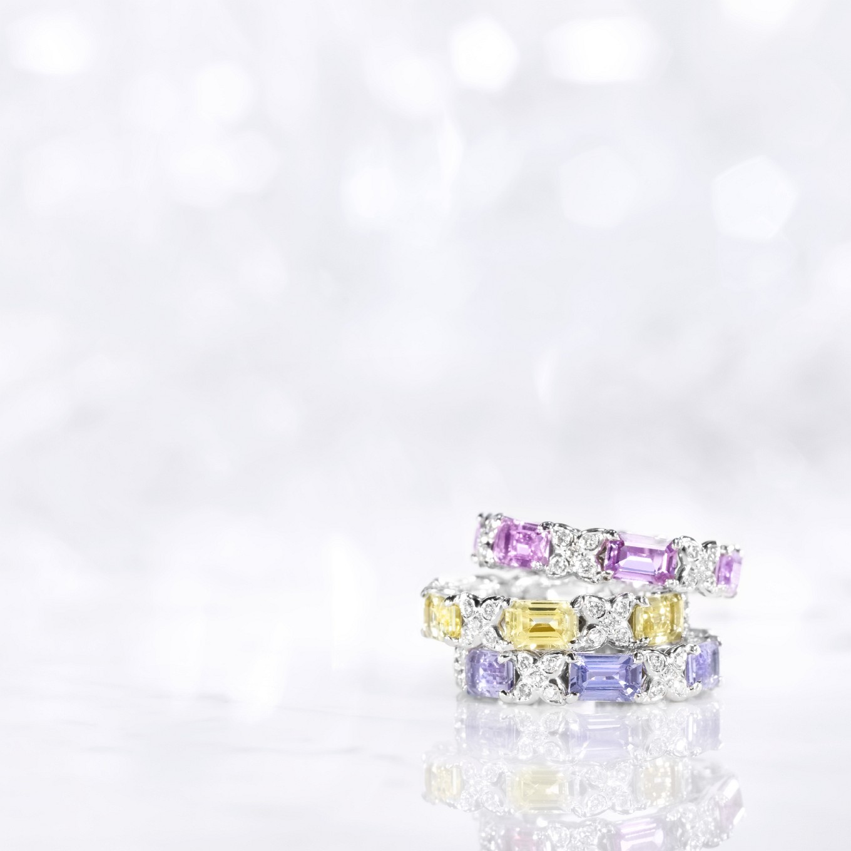 EMERALD CUT PINK, YELLOW & BLUE SAPPHIRE & DIAMOND SEVILLA ETERNITY BANDS