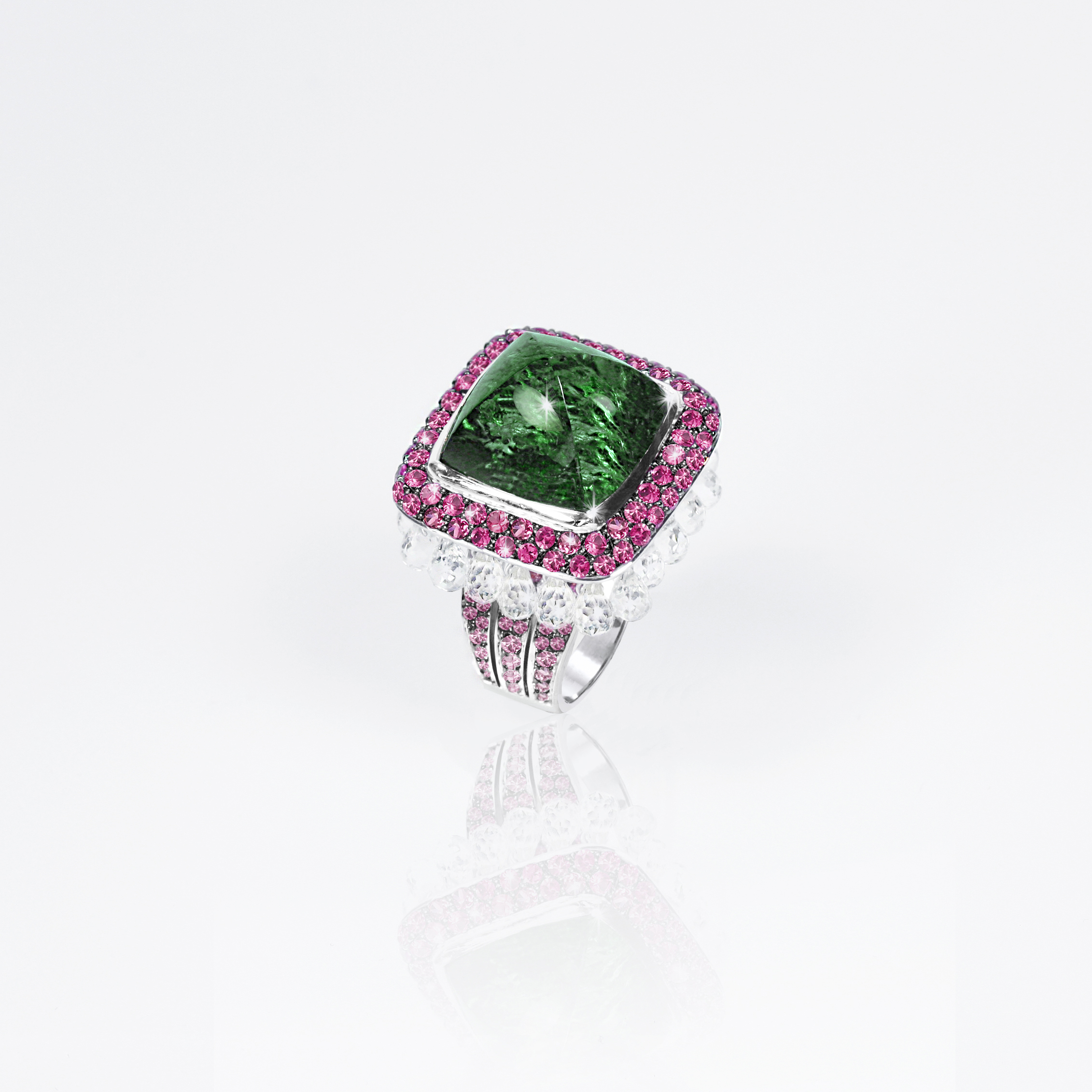 'JAIPUR' RING WITH GREEN TOURMALINE CABOCHON. PINK SAPPHIRES & WHITE TOPAZ BRIOLETTES IN WHITE GOLD