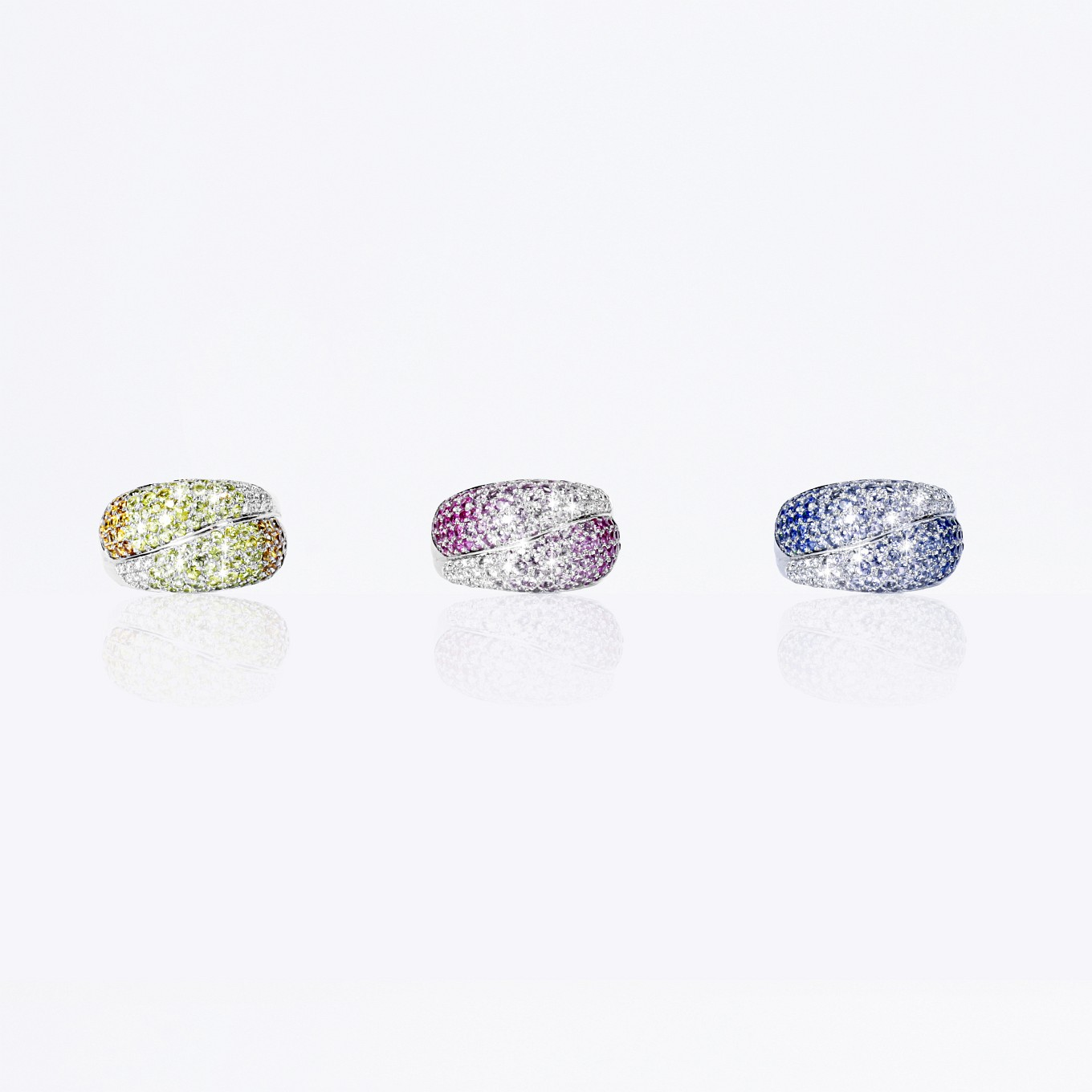 BLUE, YELLOW & PINK SAPPHIRE & DIAMOND PAVE RINGS IN WHITE GOLD