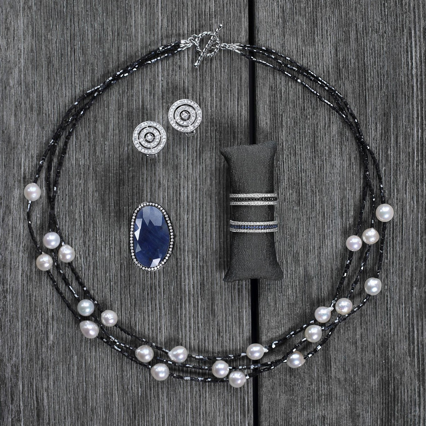 Clockwise from top left: Double Circle diamond earrings  -  JdJ Eternity bands -  Sapphire slice & Diamond ring - Black diamond & freshwater pearl necklace with white gold bar clasp