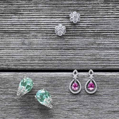 "From top    ""Snowflake"" Diamond cluster earrings in white gold -  ""Olivia"" Pink Sapphire & Diamond earrings with Sevilla motif in white gold - ""Sophie"" 19.53 ct Oval Green Tourmaline & Diamond earrings in white gold"