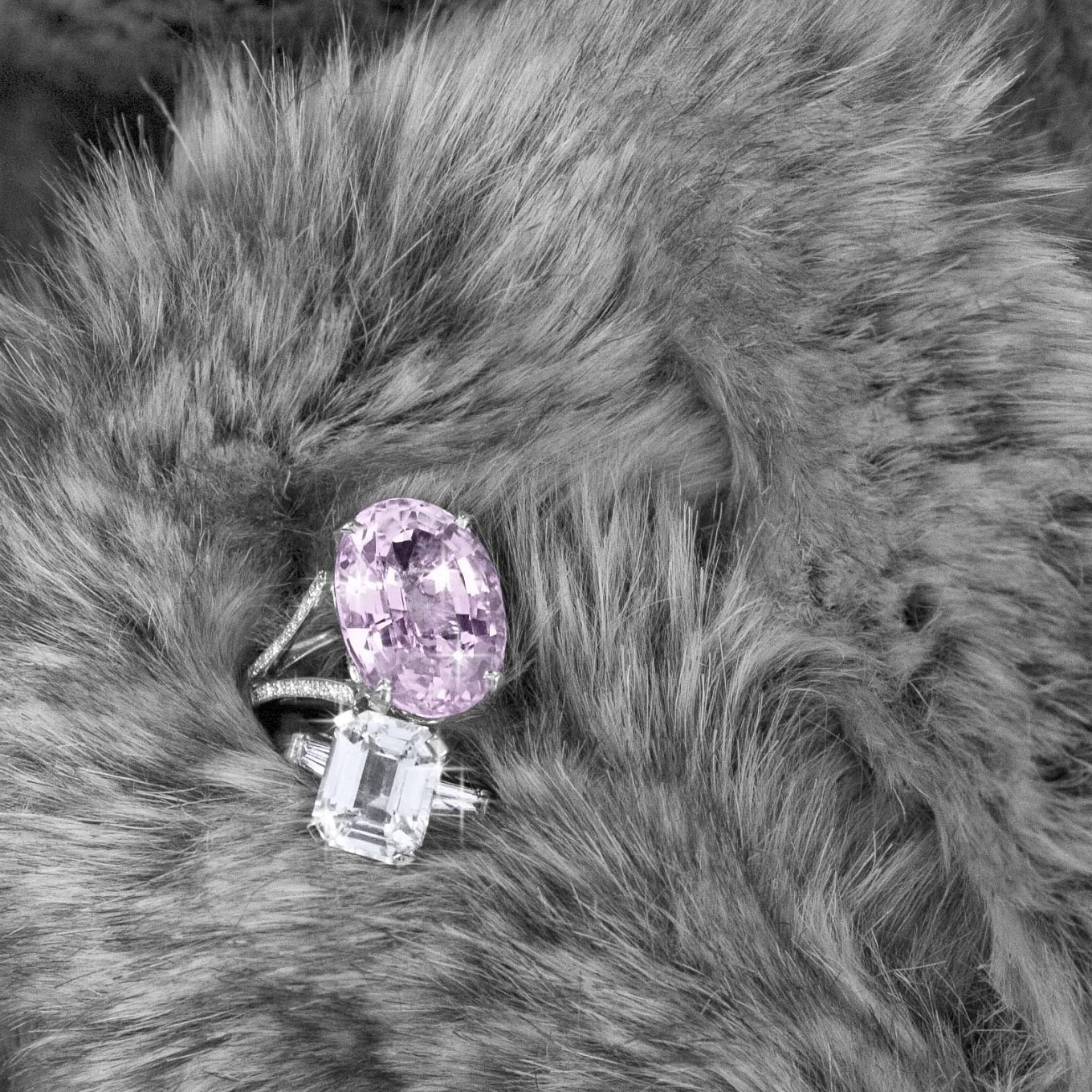 27 ct Oval Kunzite & diamond split band ring in white gold. Emerald cut diamond ring - price on request
