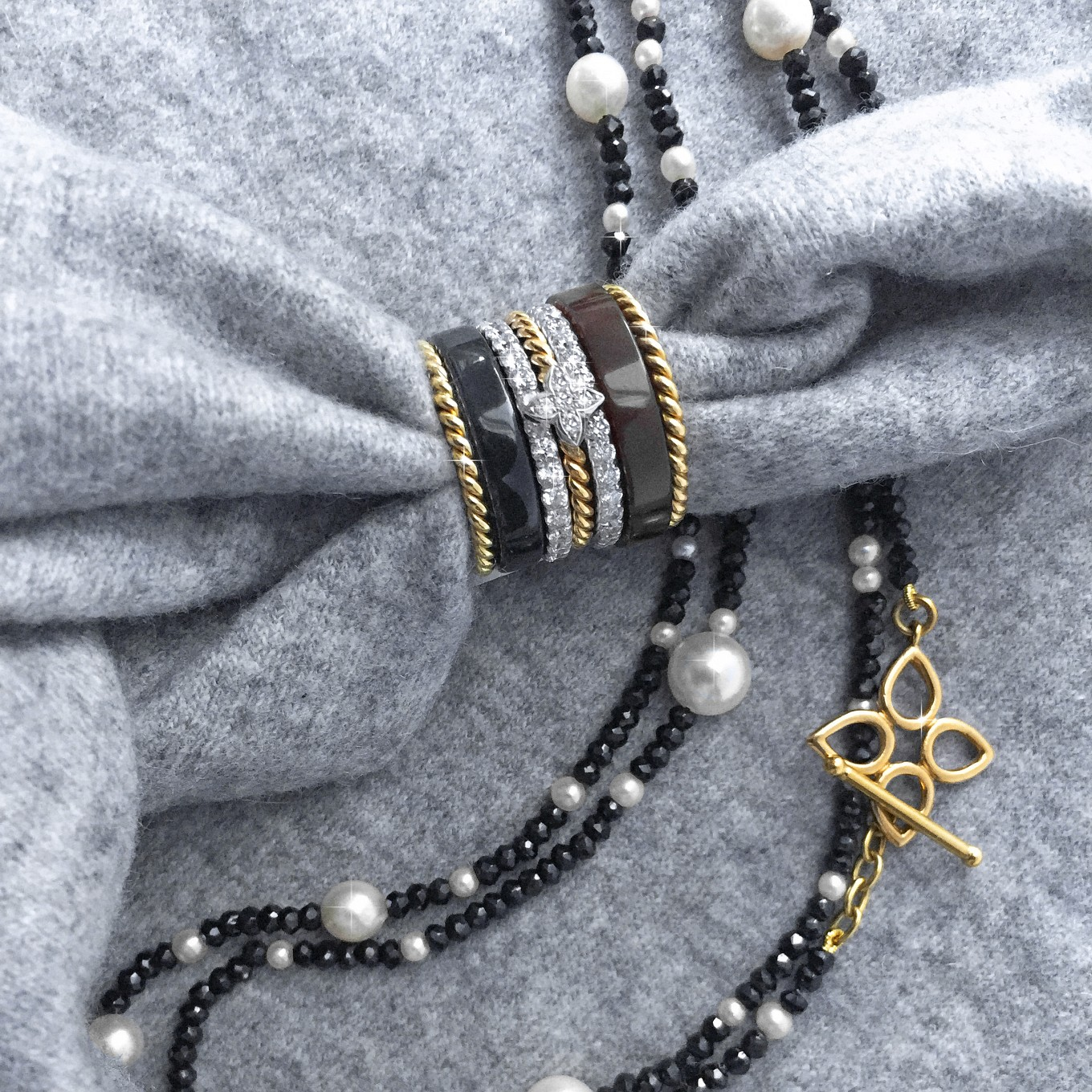 BLACK SPINEL NECKLACE WITH FRESHWATER PEARL & YELLOW GOLD CLASPBLACK JADE & CARNELIAN HARDSTONE  BANDS, BRAIDED BANDS & SEVILLA MOTIF BRAIDED BANDS