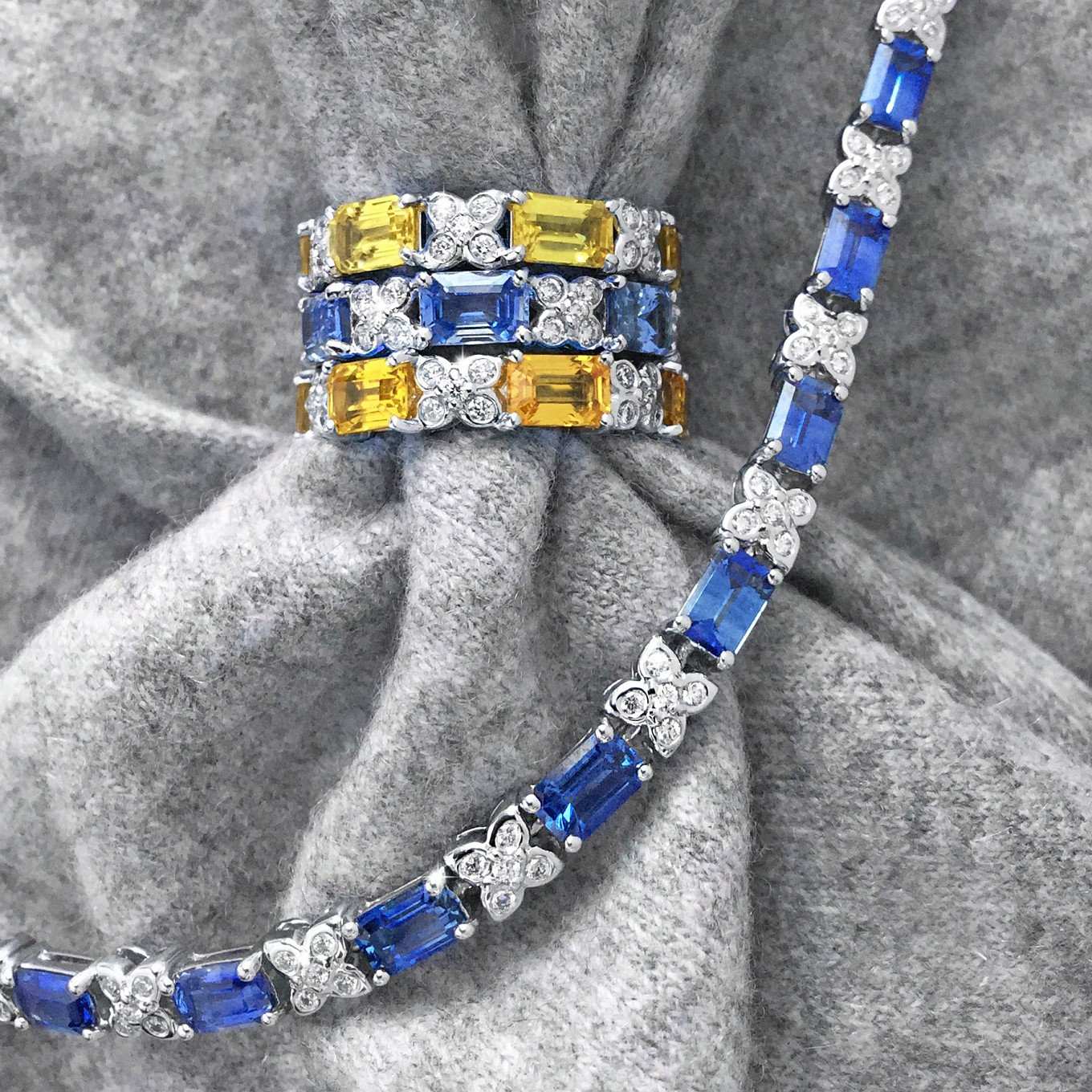 EMERALD CUT YELLOW & BLUE SAPPHIRE DIAMOND SEVILLA  ETERNITY BANDS IN WHITE GOLDEMERALD CUT SAPPHIRE 8.10 CTS & DIAMOND 0.85 CTS BRACELET IN WHITE GOLD