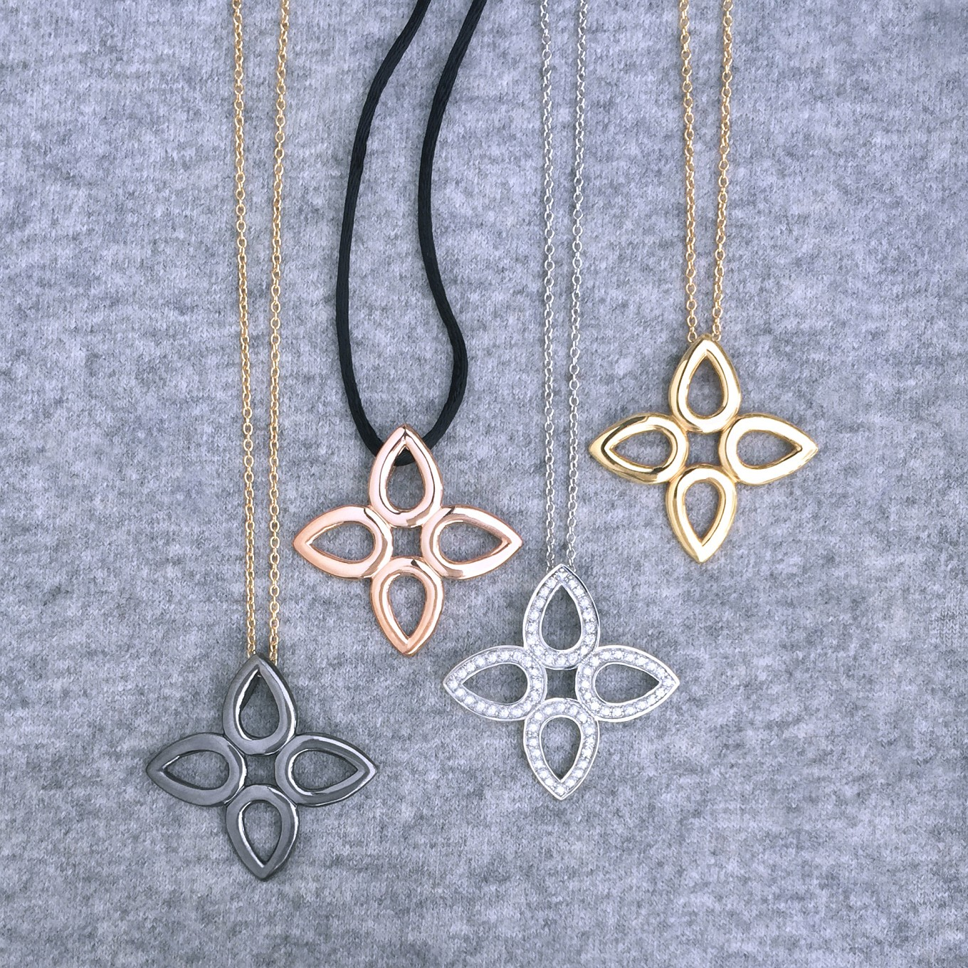 SEVILLA MOTIF PENDANTS FROM LEFT:STERLING SILVER WITH BLACK RHODIUM ON GOLD CHAINSTERLING SILVER WITH ROSE GOLD RHODIUM ON BLACK SILK CORDSTERLING SILVER WITH WHITE SAPPHIREALL YELLOW GOLDALSO AVAILABLE IN STERLING SILVER /  GOLD & DIAMOND