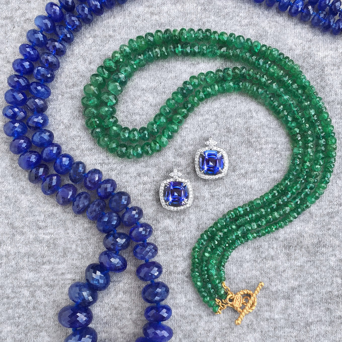 TANZANITE & EMERALD BEAD NECKLACES PRICE ON REQUEST<br/>CUSHION SHAPED TANZANITE & DIAMOND EARRINGS IN WHITE GOLD