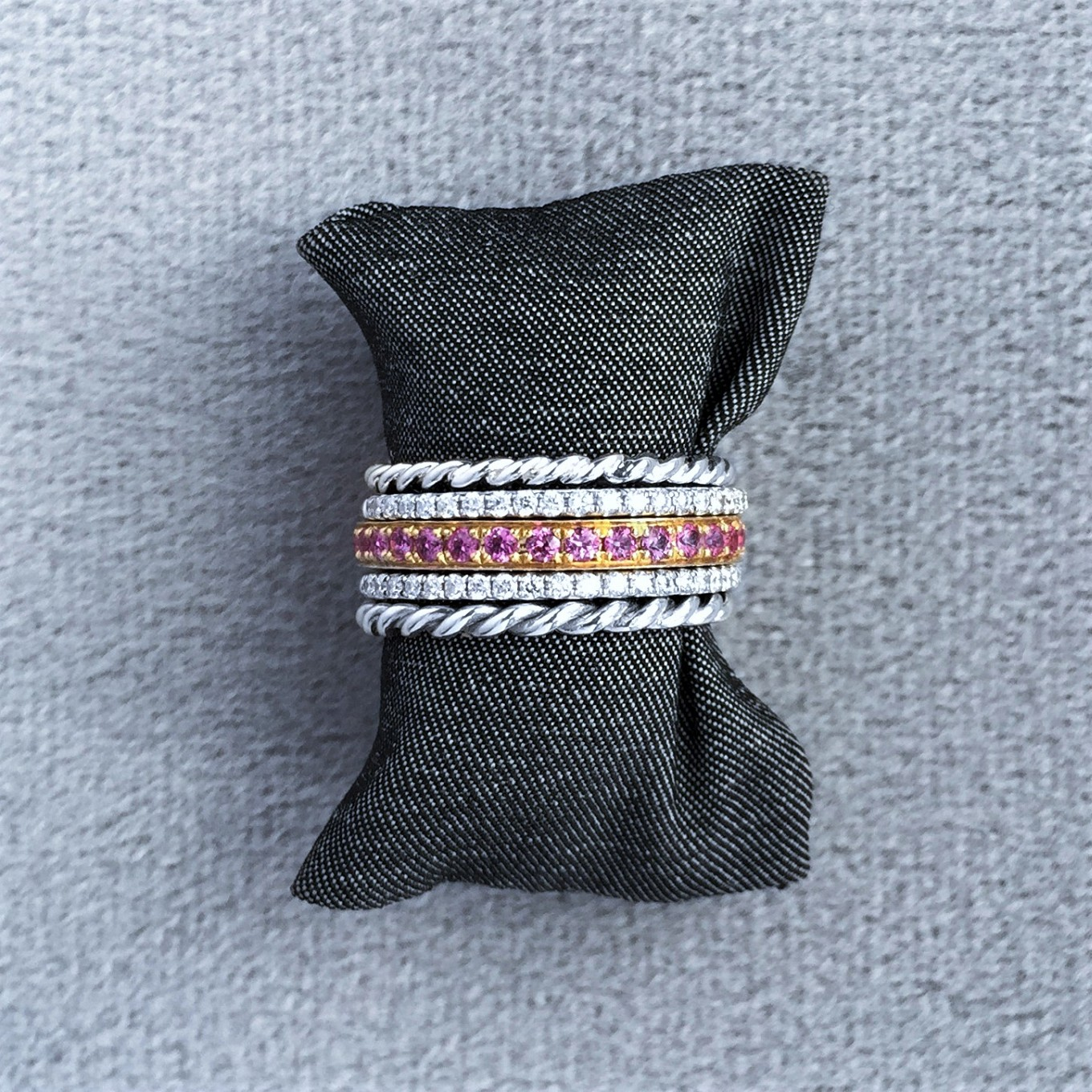 Diamond pink sapphire & braided bands in white & yellow gold
