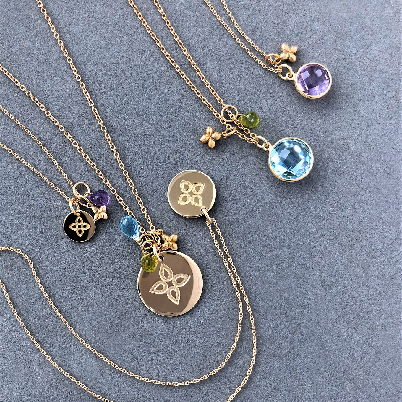 LOVE DISC & GEMSTONE PENDANTS PAIRED WITH GEMSTONE & SEVILLA CHARMS