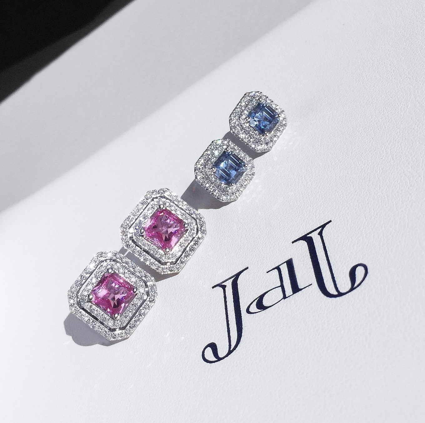 Pink & blue sapphire. frame earrings