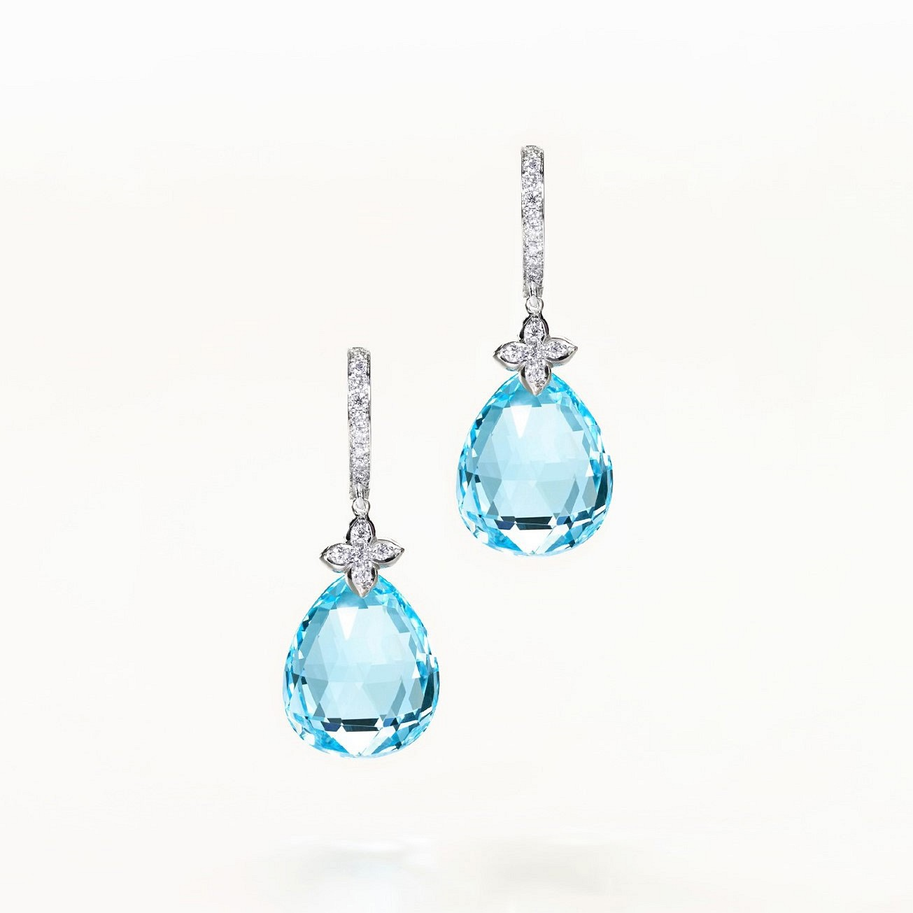 Blue Topaz pear shaped earrings. Diamonds and white gold