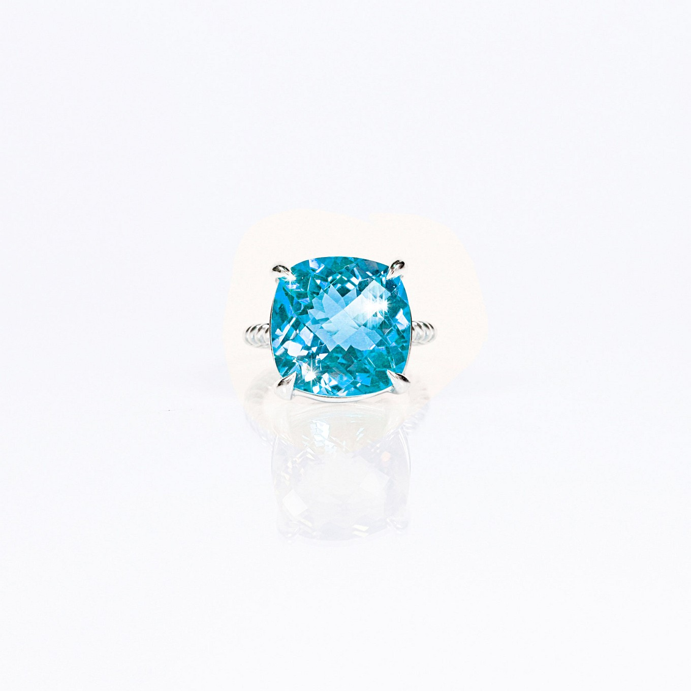Blue topaz cushion cut braid ring in sterling silver