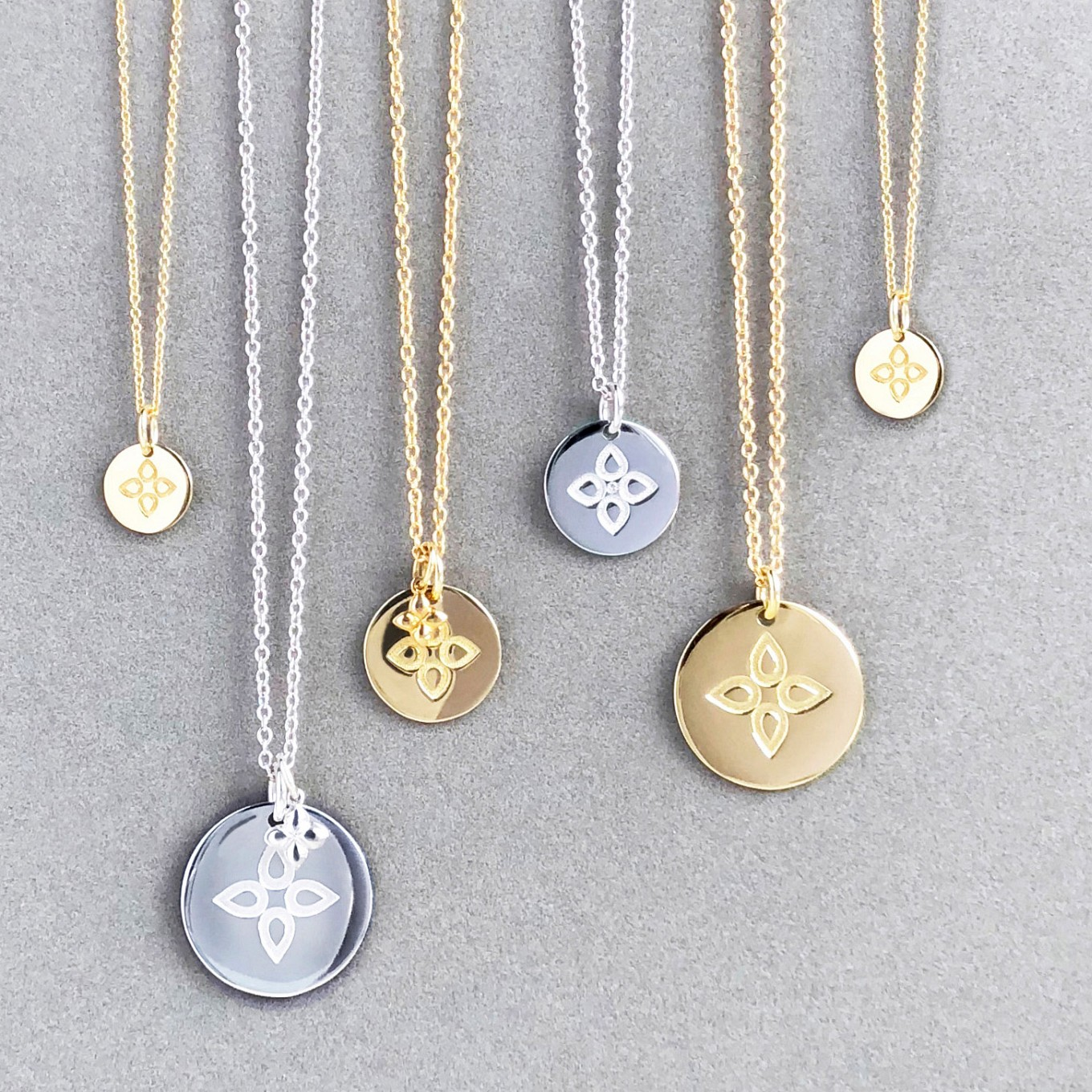 love disc pendants in sterling & yellow gold